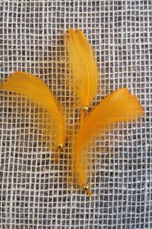 Piórka dekoracyjne kolor jasnopomarańczowy opakowanie foliowe